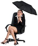 Young businesswoman holding umbrella