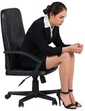 Worried businesswoman on swivel chair
