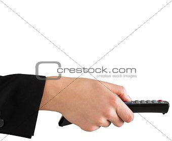 Female hand pressing remote control