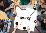 Develop on page with people sitting around table drinking coffee