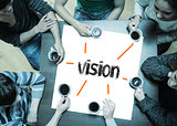 Vision on page with people sitting around table drinking coffee