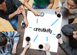 Creativity on page with people sitting around table drinking coffee