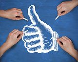 Composite image of multiple hands drawing thumbs up with chalk