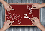 Composite image of multiple hands drawing doodles with chalk