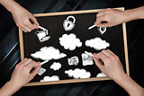 Composite image of multiple hands drawing clouds with chalk