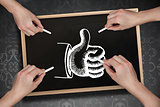 Composite image of multiple hands drawing thumb up with chalk