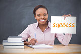 Happy teacher holding page showing success