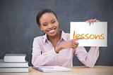 Happy teacher holding page showing lessons