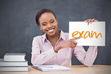 Happy teacher holding page showing exam