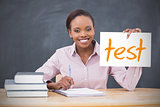 Happy teacher holding page showing test
