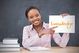 Happy teacher holding page showing knowledge