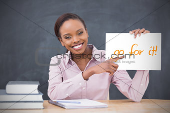 Happy teacher holding page showing go for it
