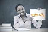Happy teacher holding page showing university