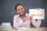 Happy teacher holding page showing seminar
