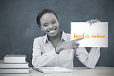 Happy teacher holding page showing books online