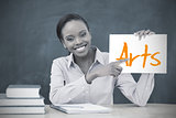 Happy teacher holding page showing arts