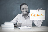 Happy teacher holding page showing german