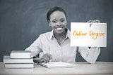 Happy teacher holding page showing online degree