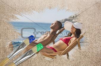 Composite image of couple lying on the beach