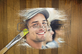Composite image of smiling designer