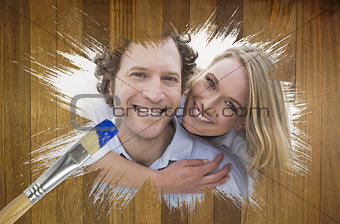 Composite image of couple smiling at camera