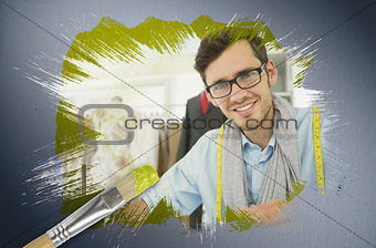 Composite image of fashion designer smiling at camera