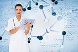 Composite image of pretty nurse using tablet pc