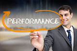 Businessman writing the word performance