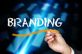 Businessman writing the word branding