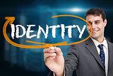 Businessman writing the word identity