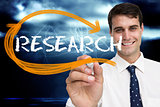 Businessman writing the word research