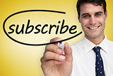 Businessman writing the word subscribe
