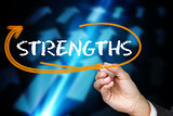 Businessman writing the word strengths