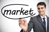 Businessman writing the word market