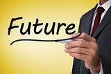 Businessman writing the word future