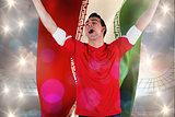 Composite image of excited football fan cheering holding iran flag