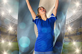 Composite image of cheering football fan in blue jersey holding argentina flag