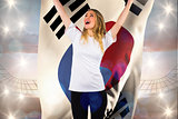 Composite image of pretty football fan in white cheering holding korea republic flag