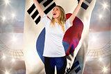Composite image of pretty football fan in white cheering holding korea republic flag