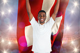 Composite image of excited handsome football fan cheering holding swiss flag