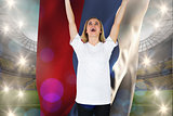 Composite image of cheering football fan in white holding russia flag