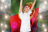 Composite image of pretty football fan in white cheering holding portugal flag