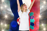 Composite image of pretty football fan in white cheering holding croatia flag