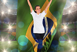 Composite image of excited football fan in white cheering holding brazil flag