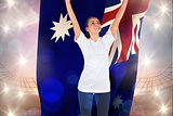 Composite image of excited football fan in white cheering holding australia flag