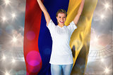 Composite image of pretty football fan in white cheering holding colombia flag