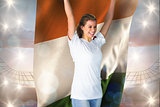 Composite image of pretty football fan in white cheering holding ivory coast flag