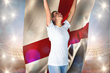 Composite image of pretty football fan in white cheering holding england flag