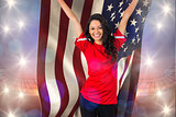 Composite image of cheering football fan in red holding usa flag