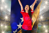Composite image of cheering football fan in red holding bosnian flag